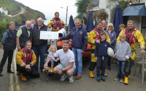 Port Isaac RNLI recieve a cheque for £1264 from the Port Gaverne Hotel